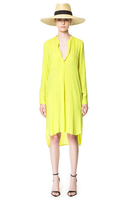 Long Asymmetric Tunic - style: tunic; neckline: shirt collar/peter pan/zip with opening; fit: loose; pattern: plain; predominant colour: primrose yellow; occasions: casual, evening, holiday; length: just above the knee; fibres: polyester/polyamide - 100%; back detail: longer hem at back than at front; sleeve length: long sleeve; sleeve style: standard; trends: fluorescent; pattern type: fabric; pattern size: standard; texture group: jersey - stretchy/drapey; season: s/s 2013