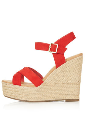 Whispered Cross Over Wedges - predominant colour: true red; occasions: casual, holiday; material: leather; heel height: high; ankle detail: ankle strap; heel: wedge; toe: open toe/peeptoe; style: standard; finish: plain; pattern: plain; season: s/s 2013