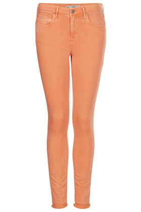 Moto Orange Leigh Jeans - style: skinny leg; length: standard; pattern: plain; pocket detail: traditional 5 pocket; waist: mid/regular rise; predominant colour: bright orange; occasions: casual, evening, holiday; fibres: cotton - stretch; jeans detail: washed/faded; texture group: denim; pattern type: fabric; season: s/s 2013