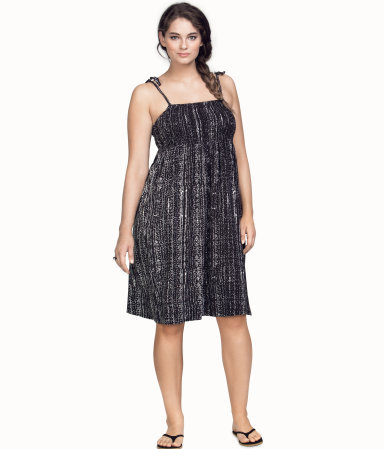 + Dress - style: empire line; sleeve style: spaghetti straps; fit: empire; secondary colour: white; predominant colour: black; length: on the knee; fibres: viscose/rayon - 100%; hip detail: subtle/flattering hip detail; sleeve length: sleeveless; occasions: holiday; neckline: low square neck; pattern type: fabric; pattern size: light/subtle; pattern: patterned/print; texture group: jersey - stretchy/drapey; season: s/s 2013