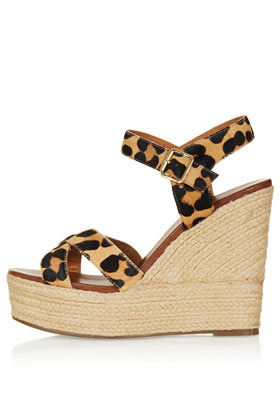 Whispered Cross Over Wedges - secondary colour: camel; predominant colour: black; occasions: casual, holiday; material: leather; ankle detail: ankle strap; heel: wedge; toe: open toe/peeptoe; style: strappy; finish: plain; pattern: animal print; heel height: very high; season: s/s 2013