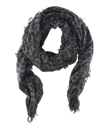Scarf - secondary colour: charcoal; predominant colour: mid grey; occasions: casual, evening, work, holiday; type of pattern: heavy; style: regular; size: standard; material: fabric; embellishment: fringing; pattern: animal print; trends: statement prints; season: s/s 2013