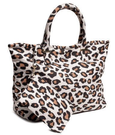 Bag - secondary colour: tan; predominant colour: stone; occasions: casual, work, holiday; type of pattern: heavy; style: tote; length: handle; size: standard; material: fabric; pattern: animal print; trends: statement prints; finish: plain; season: s/s 2013