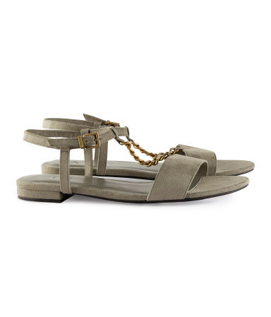 Sandals - predominant colour: khaki; secondary colour: gold; occasions: casual; material: faux leather; heel height: flat; ankle detail: ankle strap; heel: standard; toe: open toe/peeptoe; style: standard; finish: plain; pattern: plain; embellishment: chain/metal; season: s/s 2013