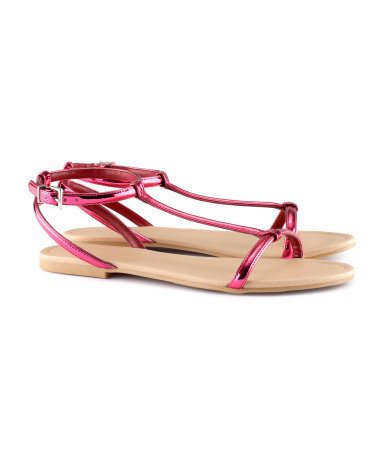 Sandals - predominant colour: hot pink; occasions: casual; material: faux leather; heel height: flat; ankle detail: ankle strap; heel: standard; toe: open toe/peeptoe; style: standard; finish: metallic; pattern: plain; season: s/s 2013