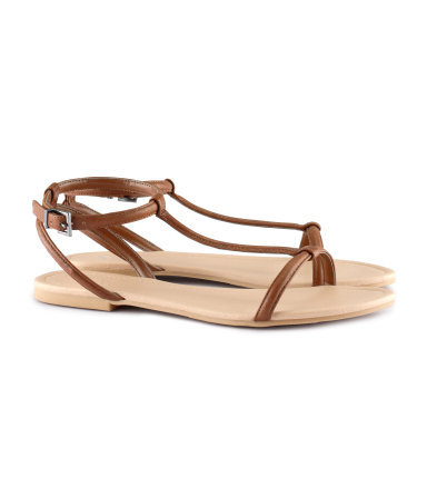 Sandals - predominant colour: tan; occasions: casual, holiday; material: faux leather; heel height: flat; ankle detail: ankle strap; heel: standard; toe: open toe/peeptoe; style: standard; finish: plain; pattern: plain; season: s/s 2013