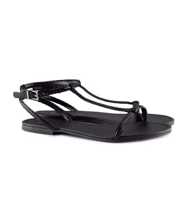 Sandals - predominant colour: black; occasions: casual, holiday; material: faux leather; heel height: flat; ankle detail: ankle strap; heel: standard; toe: open toe/peeptoe; style: standard; finish: patent; pattern: plain; season: s/s 2013