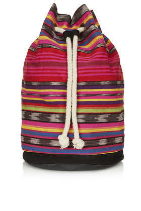 Aztec Duffle Backpack - secondary colour: black; occasions: casual, holiday; predominant colour: multicoloured; type of pattern: heavy; style: rucksack; length: rucksack; size: standard; material: fabric; embellishment: tassels; trends: striking stripes; finish: plain; pattern: patterned/print; season: s/s 2013; multicoloured: multicoloured