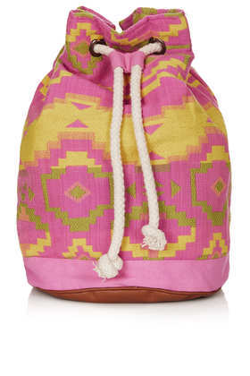 Neon Aztec Duffle Backpack - predominant colour: hot pink; secondary colour: yellow; occasions: casual, holiday; type of pattern: large; style: rucksack; length: rucksack; size: standard; material: fabric; embellishment: tassels; trends: modern geometrics; finish: plain; pattern: patterned/print; season: s/s 2013
