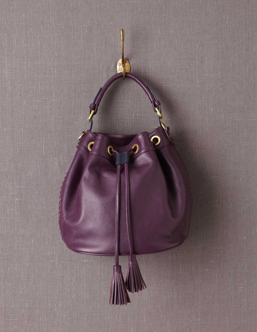 Leather Pouch Bag - predominant colour: aubergine; occasions: casual; style: onion bag; length: handle; size: standard; material: leather; embellishment: tassels; pattern: plain; finish: plain; season: a/w 2013