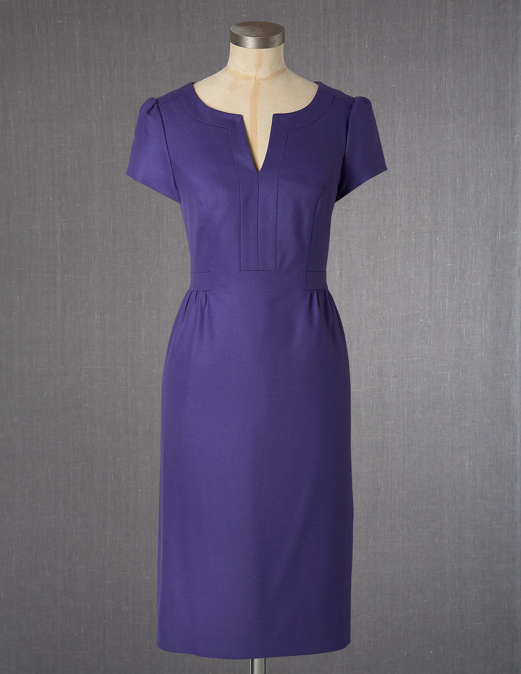 Wool Tulip Dress - style: shift; neckline: v-neck; fit: tailored/fitted; pattern: plain; predominant colour: purple; occasions: casual, work, occasion; length: on the knee; fibres: wool - stretch; sleeve length: short sleeve; sleeve style: standard; pattern type: fabric; pattern size: standard; texture group: other - light to midweight; season: a/w 2013
