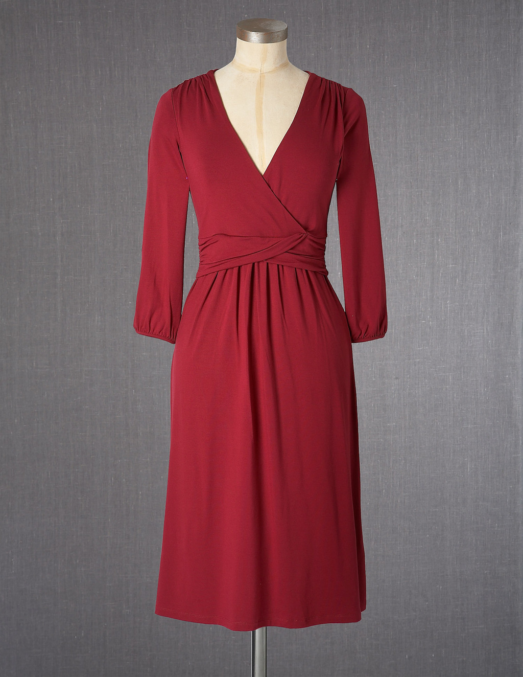 Edie Dress - style: faux wrap/wrap; neckline: v-neck; fit: fitted at waist; pattern: plain; waist detail: twist front waist detail/nipped in at waist on one side/soft pleats/draping/ruching/gathering waist detail; predominant colour: burgundy; occasions: casual; length: on the knee; fibres: viscose/rayon - stretch; sleeve length: 3/4 length; sleeve style: standard; pattern type: fabric; texture group: jersey - stretchy/drapey; season: a/w 2013