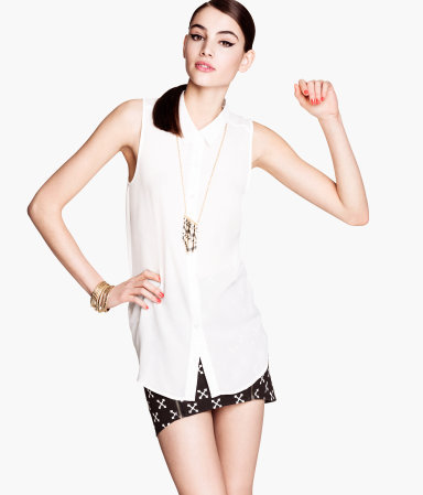Sleeveless Blouse - neckline: shirt collar/peter pan/zip with opening; pattern: plain; sleeve style: sleeveless; length: below the bottom; style: blouse; predominant colour: white; occasions: casual, evening, work; fibres: polyester/polyamide - 100%; fit: straight cut; sleeve length: sleeveless; texture group: sheer fabrics/chiffon/organza etc.; trends: tuxedo; pattern type: fabric; season: s/s 2013