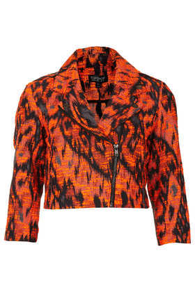 Cropped Aztec Biker Jacket - style: biker; collar: asymmetric biker; predominant colour: true red; secondary colour: black; occasions: casual, evening, work; fit: tailored/fitted; fibres: acrylic - mix; sleeve length: 3/4 length; sleeve style: standard; trends: statement prints; collar break: medium; pattern type: fabric; pattern size: standard; pattern: animal print; texture group: tweed - light/midweight; season: s/s 2013; length: cropped