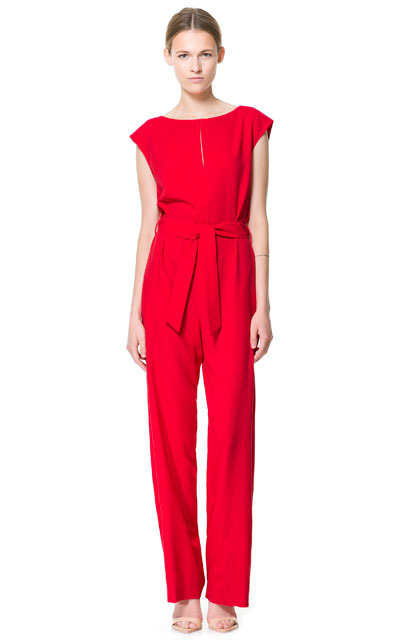 Flowing Jumpsuit With Belt - length: standard; neckline: slash/boat neckline; sleeve style: capped; pattern: plain; waist detail: belted waist/tie at waist/drawstring; predominant colour: true red; occasions: casual, evening, occasion; fit: body skimming; jeans & bottoms detail: turn ups; sleeve length: sleeveless; texture group: crepes; style: jumpsuit; pattern type: fabric; fibres: viscose/rayon - mix; season: s/s 2013
