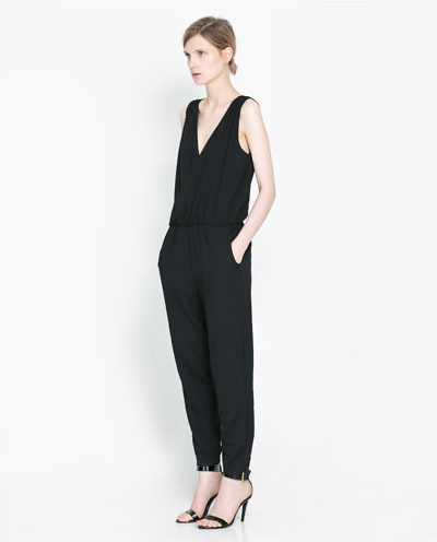 Jumpsuit With Elastic Waist - length: standard; neckline: low v-neck; fit: fitted at waist; pattern: plain; sleeve style: sleeveless; waist detail: elasticated waist; predominant colour: black; occasions: casual, evening; sleeve length: sleeveless; texture group: crepes; style: jumpsuit; pattern type: fabric; fibres: viscose/rayon - mix; season: s/s 2013