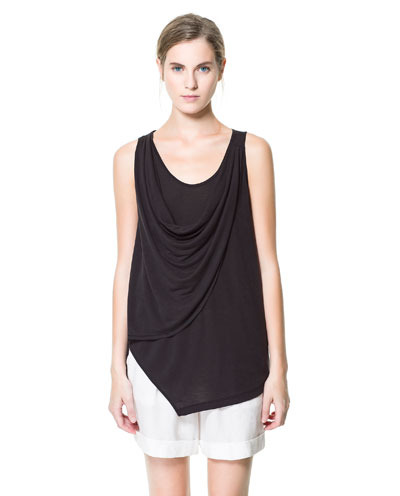 T Shirt With Draped Neckline - sleeve style: standard vest straps/shoulder straps; pattern: plain; length: below the bottom; style: vest top; bust detail: ruching/gathering/draping/layers/pintuck pleats at bust; predominant colour: black; occasions: casual, evening, work, holiday; neckline: scoop; fibres: viscose/rayon - 100%; fit: loose; sleeve length: sleeveless; pattern type: fabric; texture group: jersey - stretchy/drapey; season: s/s 2013