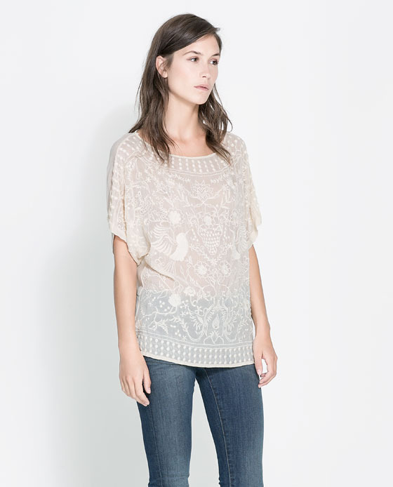 Blouse With Embroidered Front - neckline: round neck; sleeve style: dolman/batwing; length: below the bottom; style: blouse; predominant colour: blush; occasions: casual, evening, occasion, holiday; fibres: viscose/rayon - 100%; fit: straight cut; sleeve length: half sleeve; texture group: sheer fabrics/chiffon/organza etc.; pattern type: fabric; pattern size: standard; pattern: patterned/print; embellishment: embroidered; season: s/s 2013