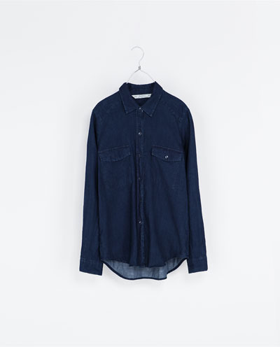 Dark Blue Shirt - neckline: shirt collar/peter pan/zip with opening; pattern: plain; length: below the bottom; style: shirt; predominant colour: navy; occasions: casual; fibres: cotton - 100%; fit: loose; back detail: longer hem at back than at front; sleeve length: long sleeve; sleeve style: standard; texture group: denim; pattern type: fabric; trends: broody brights; season: s/s 2013