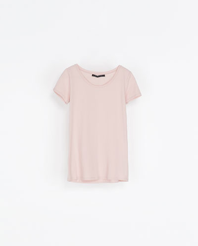 Round Neck T Shirt - neckline: round neck; pattern: plain; style: t-shirt; predominant colour: blush; occasions: casual; length: standard; fibres: cotton - stretch; fit: body skimming; sleeve length: short sleeve; sleeve style: standard; pattern type: fabric; texture group: jersey - stretchy/drapey; season: s/s 2013