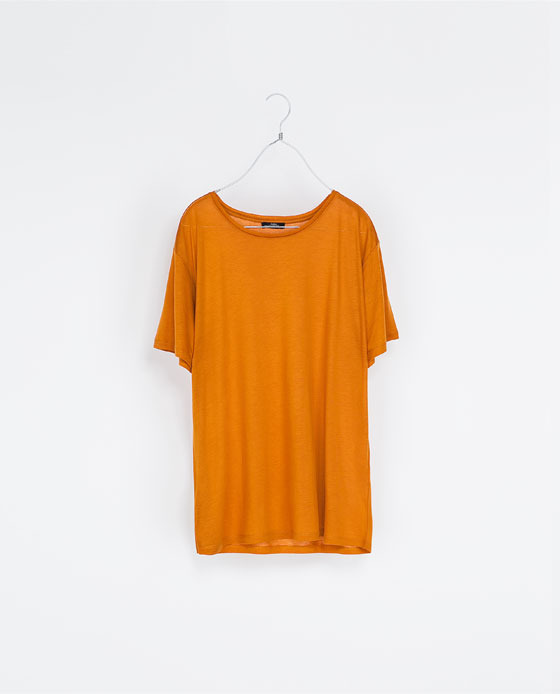 Round Neck T Shirt - neckline: round neck; pattern: plain; style: t-shirt; predominant colour: bright orange; occasions: casual; length: standard; fibres: viscose/rayon - 100%; fit: straight cut; sleeve length: short sleeve; sleeve style: standard; pattern type: fabric; texture group: jersey - stretchy/drapey; season: s/s 2013