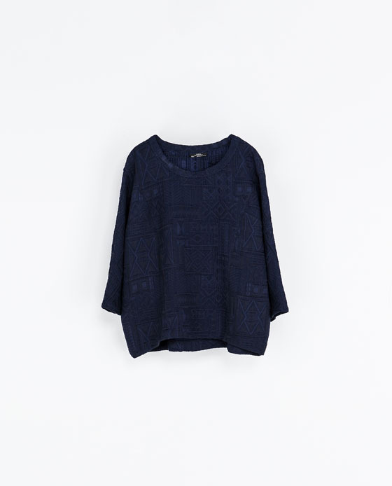 Round Neck T Shirt - neckline: round neck; pattern: plain; style: t-shirt; predominant colour: navy; occasions: casual; length: standard; fibres: polyester/polyamide - mix; fit: loose; back detail: longer hem at back than at front; sleeve length: 3/4 length; sleeve style: standard; pattern type: fabric; pattern size: light/subtle; texture group: other - light to midweight; trends: oversized structure, broody brights; season: a/w 2013