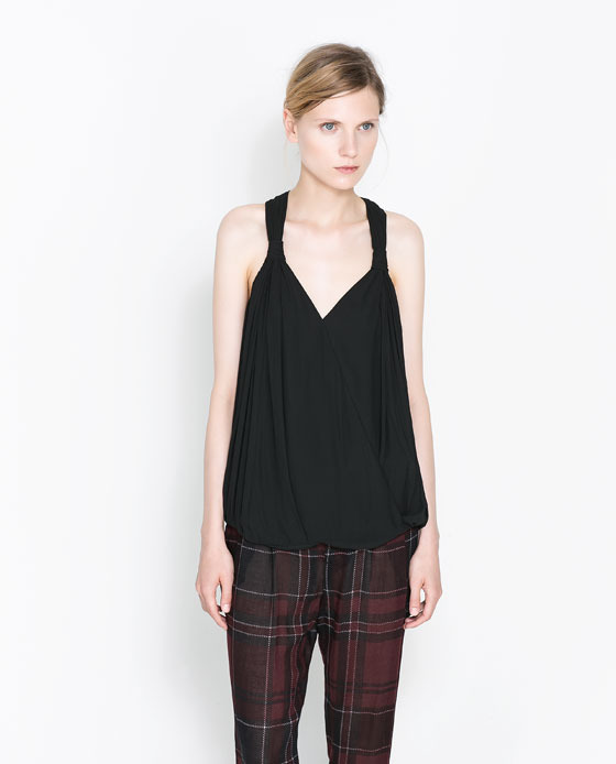 Top With Crossover Knotted Back - neckline: low v-neck; sleeve style: standard vest straps/shoulder straps; pattern: plain; back detail: racer back/sports back; predominant colour: black; occasions: casual, evening, occasion, holiday; length: standard; style: top; fibres: polyester/polyamide - 100%; fit: loose; sleeve length: sleeveless; pattern type: fabric; texture group: jersey - stretchy/drapey; season: a/w 2013