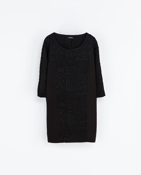 Dress With Three Quarter Sleeves - style: tunic; length: mid thigh; neckline: round neck; fit: loose; pattern: plain; predominant colour: black; occasions: casual, evening; fibres: polyester/polyamide - mix; sleeve length: 3/4 length; sleeve style: standard; pattern type: fabric; texture group: woven light midweight; season: a/w 2013
