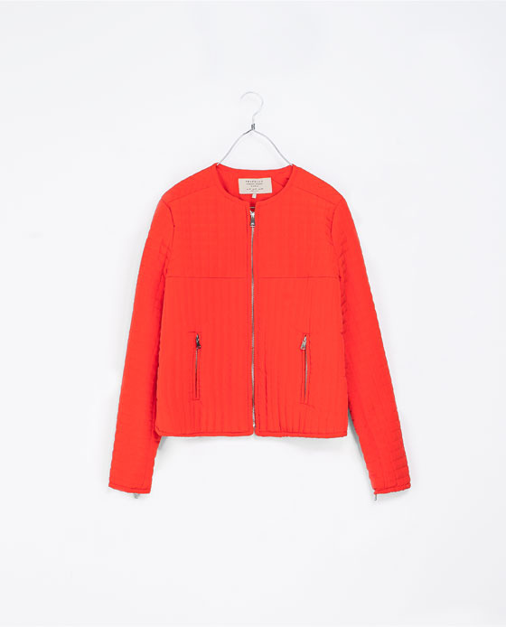 Quilted Jacket With Zip - pattern: plain; collar: round collar/collarless; style: bomber; predominant colour: bright orange; occasions: casual; length: standard; fit: straight cut (boxy); fibres: polyester/polyamide - 100%; sleeve length: long sleeve; sleeve style: standard; collar break: high; pattern type: fabric; texture group: other - light to midweight; embellishment: quilted; season: a/w 2013