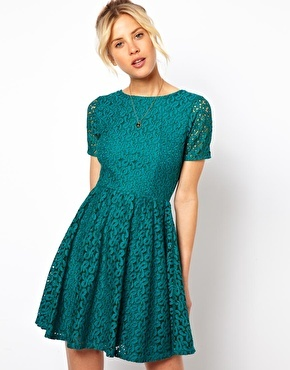 Skater Dress In Lace - length: mid thigh; predominant colour: emerald green; occasions: evening, occasion; fit: fitted at waist & bust; style: fit & flare; fibres: cotton - mix; neckline: crew; hip detail: soft pleats at hip/draping at hip/flared at hip; sleeve length: short sleeve; sleeve style: standard; texture group: lace; pattern type: fabric; pattern: patterned/print; embellishment: lace; trends: gothic romance, broody brights; season: a/w 2013