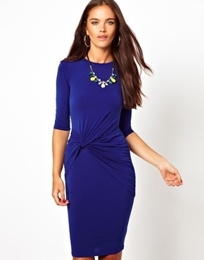 Long Sleeve Twist Front Drape Dress With Necklace - style: shift; fit: tight; pattern: plain; waist detail: twist front waist detail/nipped in at waist on one side/soft pleats/draping/ruching/gathering waist detail; predominant colour: royal blue; occasions: casual, evening, work, occasion, creative work; length: on the knee; fibres: polyester/polyamide - stretch; neckline: crew; hip detail: ruching/gathering at hip; sleeve length: half sleeve; sleeve style: standard; pattern type: fabric; texture group: jersey - stretchy/drapey; trends: broody brights; season: a/w 2013
