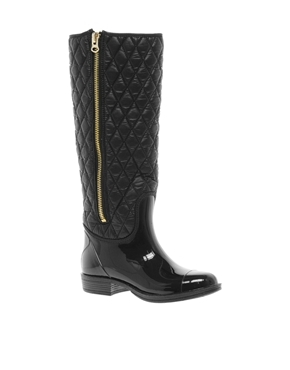 Quilted Wellington Boots - predominant colour: black; occasions: casual, creative work; material: plastic/rubber; heel height: mid; embellishment: quilted; heel: standard; toe: round toe; boot length: knee; style: wellies; finish: patent; pattern: plain; season: a/w 2013