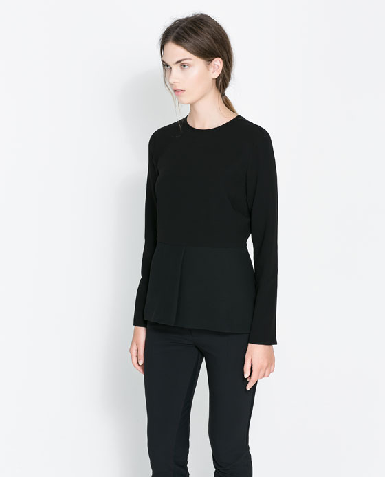 Round Neck Top - neckline: round neck; pattern: plain; waist detail: peplum waist detail; predominant colour: black; occasions: casual, evening, work, creative work; length: standard; style: top; fibres: polyester/polyamide - mix; fit: tailored/fitted; sleeve length: long sleeve; sleeve style: standard; texture group: jersey - stretchy/drapey; season: a/w 2013