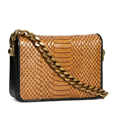 Bag - predominant colour: tan; secondary colour: gold; occasions: casual, creative work; type of pattern: small; style: clutch; length: shoulder (tucks under arm); size: small; material: leather; pattern: animal print; finish: plain; embellishment: chain/metal; season: a/w 2013
