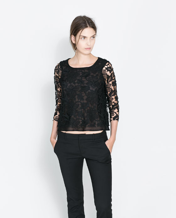 Cropped Guipure Lace Top - neckline: round neck; predominant colour: black; occasions: evening, occasion, creative work; length: standard; style: top; fibres: polyester/polyamide - 100%; fit: straight cut; sleeve length: 3/4 length; sleeve style: standard; texture group: lace; pattern type: fabric; pattern: patterned/print; embellishment: lace; trends: gothic romance; season: a/w 2013