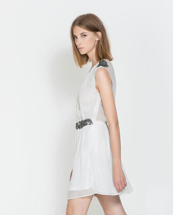 Dress With Detail On Shoulders And Waist - style: shift; length: mid thigh; neckline: round neck; fit: fitted at waist; pattern: plain; sleeve style: sleeveless; predominant colour: white; occasions: evening, occasion, holiday, creative work; fibres: polyester/polyamide - 100%; sleeve length: sleeveless; texture group: sheer fabrics/chiffon/organza etc.; pattern type: fabric; embellishment: beading; season: a/w 2013; wardrobe: highlight; embellishment location: hip, shoulder, waist