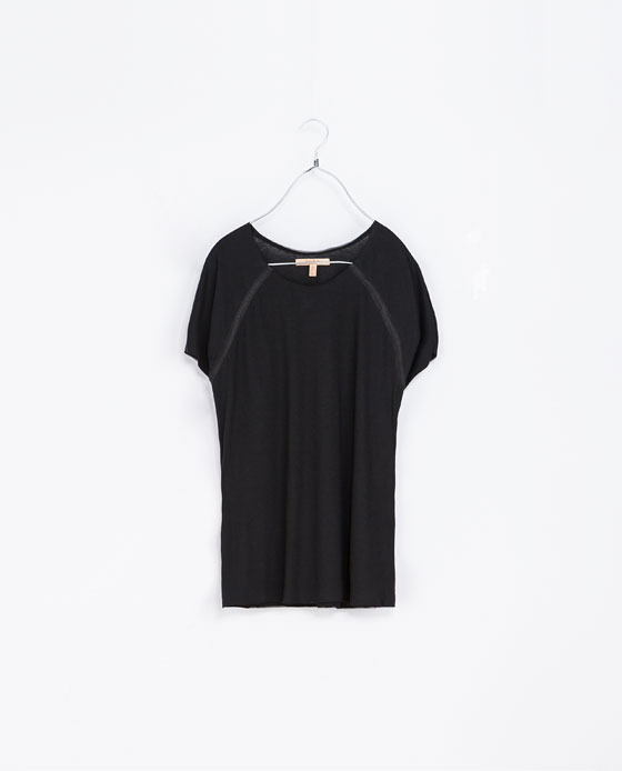 T Shirt With Faux Leather Seams - neckline: round neck; pattern: plain; style: t-shirt; predominant colour: black; occasions: casual, evening, creative work; length: standard; fibres: cotton - mix; fit: loose; sleeve length: short sleeve; sleeve style: standard; pattern type: fabric; texture group: jersey - stretchy/drapey; season: a/w 2013