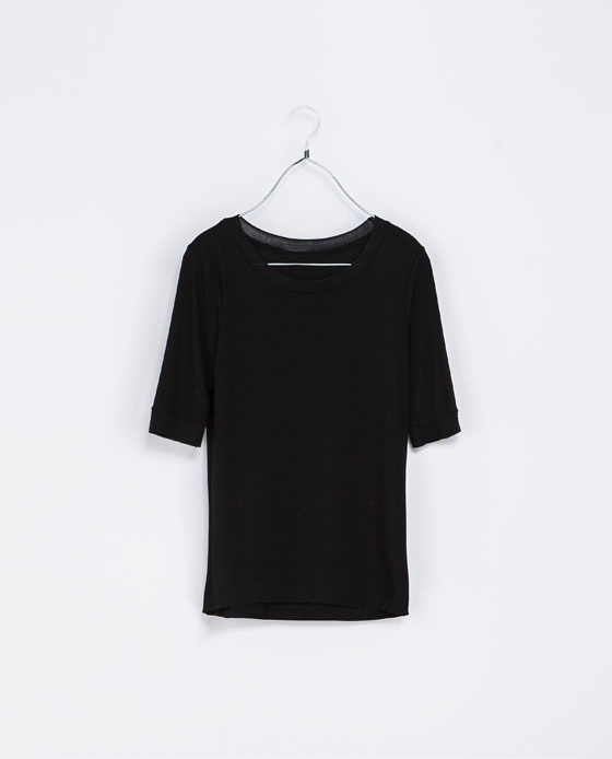 3/4 Sleeve T Shirt - neckline: round neck; pattern: plain; style: t-shirt; predominant colour: black; occasions: casual, creative work; length: standard; fibres: polyester/polyamide - stretch; fit: tight; sleeve length: short sleeve; sleeve style: standard; pattern type: fabric; texture group: jersey - stretchy/drapey; season: a/w 2013