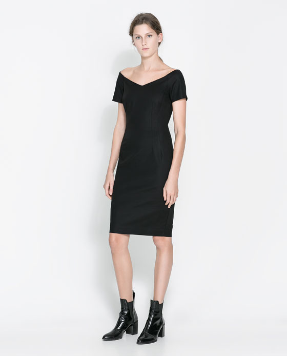 V Neck Dress - style: shift; neckline: off the shoulder; fit: tailored/fitted; pattern: plain; predominant colour: black; occasions: evening, work, occasion, creative work; length: just above the knee; fibres: cotton - stretch; sleeve length: short sleeve; sleeve style: standard; texture group: cotton feel fabrics; season: a/w 2013
