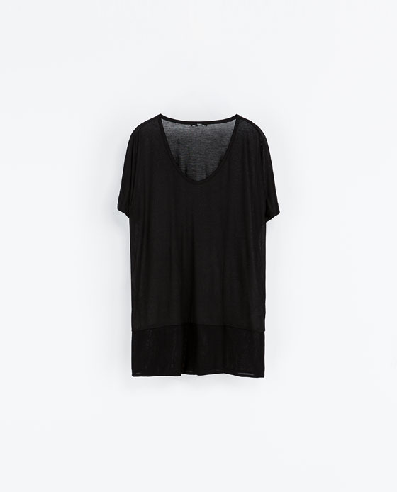 T Shirt With Low Neckline - neckline: low v-neck; pattern: plain; length: below the bottom; style: t-shirt; predominant colour: black; occasions: casual, creative work; fibres: viscose/rayon - 100%; fit: loose; sleeve length: short sleeve; sleeve style: standard; texture group: jersey - stretchy/drapey; season: a/w 2013