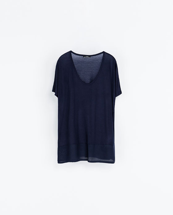 T Shirt With Low Neckline - neckline: v-neck; pattern: plain; length: below the bottom; style: t-shirt; predominant colour: navy; occasions: casual, creative work; fibres: polyester/polyamide - 100%; fit: loose; sleeve length: short sleeve; sleeve style: standard; texture group: jersey - stretchy/drapey; trends: broody brights; season: a/w 2013