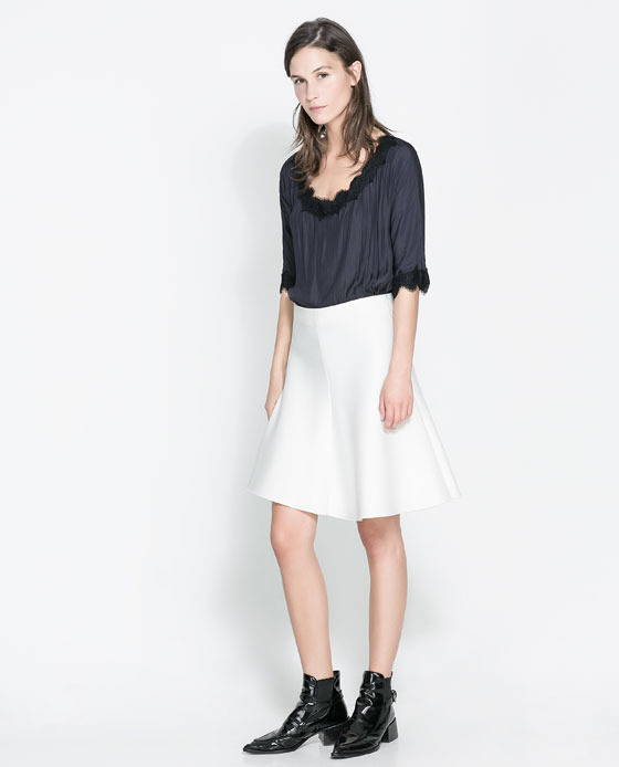 Flared Skirt - pattern: plain; fit: loose/voluminous; waist: high rise; predominant colour: white; occasions: casual, evening, work, creative work; length: just above the knee; style: fit & flare; fibres: polyester/polyamide - stretch; pattern type: fabric; texture group: other - light to midweight; season: a/w 2013