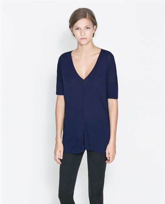 T Shirt With Back Zip - neckline: low v-neck; pattern: plain; style: t-shirt; predominant colour: navy; occasions: casual, work, creative work; length: standard; fibres: viscose/rayon - 100%; fit: loose; sleeve length: short sleeve; sleeve style: standard; texture group: jersey - stretchy/drapey; trends: broody brights; season: a/w 2013