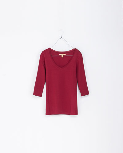 3/4 Sleeve T Shirt - neckline: low v-neck; pattern: plain; style: t-shirt; occasions: casual, evening, work, creative work; length: standard; fibres: cotton - stretch; fit: tight; sleeve length: 3/4 length; sleeve style: standard; texture group: jersey - stretchy/drapey; trends: broody brights; predominant colour: raspberry; season: a/w 2013