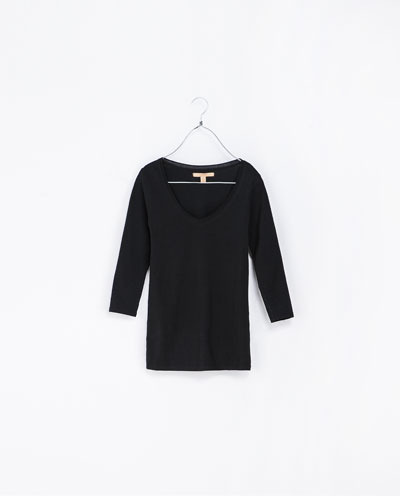 3/4 Sleeve T Shirt - neckline: v-neck; pattern: plain; style: t-shirt; predominant colour: black; occasions: casual, evening, work, creative work; length: standard; fibres: cotton - stretch; fit: tight; sleeve length: 3/4 length; sleeve style: standard; texture group: jersey - stretchy/drapey; season: a/w 2013
