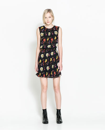 Printed Dress - style: shift; length: mid thigh; neckline: round neck; fit: fitted at waist; sleeve style: sleeveless; waist detail: elasticated waist; secondary colour: primrose yellow; predominant colour: black; occasions: casual, evening, creative work; fibres: polyester/polyamide - 100%; hip detail: soft pleats at hip/draping at hip/flared at hip; sleeve length: sleeveless; texture group: sheer fabrics/chiffon/organza etc.; pattern type: fabric; pattern: florals; season: a/w 2013