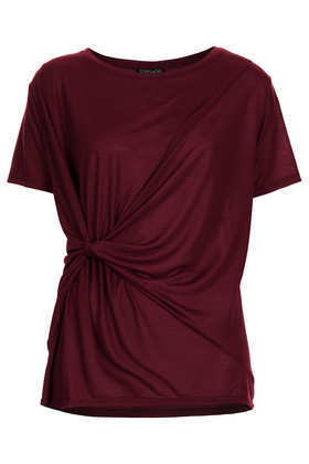 Knot Front Tee - neckline: round neck; pattern: plain; length: below the bottom; style: t-shirt; waist detail: twist front waist detail/nipped in at waist on one side/soft pleats/draping/ruching/gathering waist detail; predominant colour: burgundy; occasions: casual, creative work; fibres: polyester/polyamide - 100%; fit: loose; hip detail: soft pleats at hip/draping at hip/flared at hip; sleeve length: short sleeve; sleeve style: standard; pattern type: fabric; texture group: jersey - stretchy/drapey; trends: broody brights; season: a/w 2013