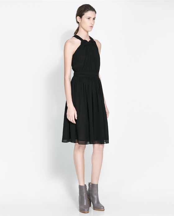 Loose Fit Knot Dress - style: shift; pattern: plain; sleeve style: sleeveless; neckline: low halter neck; predominant colour: black; occasions: evening, occasion, creative work; length: on the knee; fit: fitted at waist & bust; fibres: polyester/polyamide - 100%; sleeve length: sleeveless; texture group: sheer fabrics/chiffon/organza etc.; trends: gothic romance; season: a/w 2013