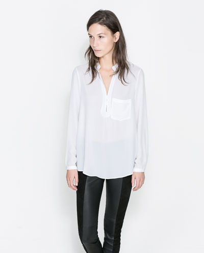Blouse - pattern: plain; length: below the bottom; predominant colour: white; occasions: casual, evening, work, creative work; style: top; neckline: collarstand & mandarin with v-neck; fibres: polyester/polyamide - 100%; fit: loose; sleeve length: long sleeve; sleeve style: standard; texture group: silky - light; pattern type: fabric; season: a/w 2013