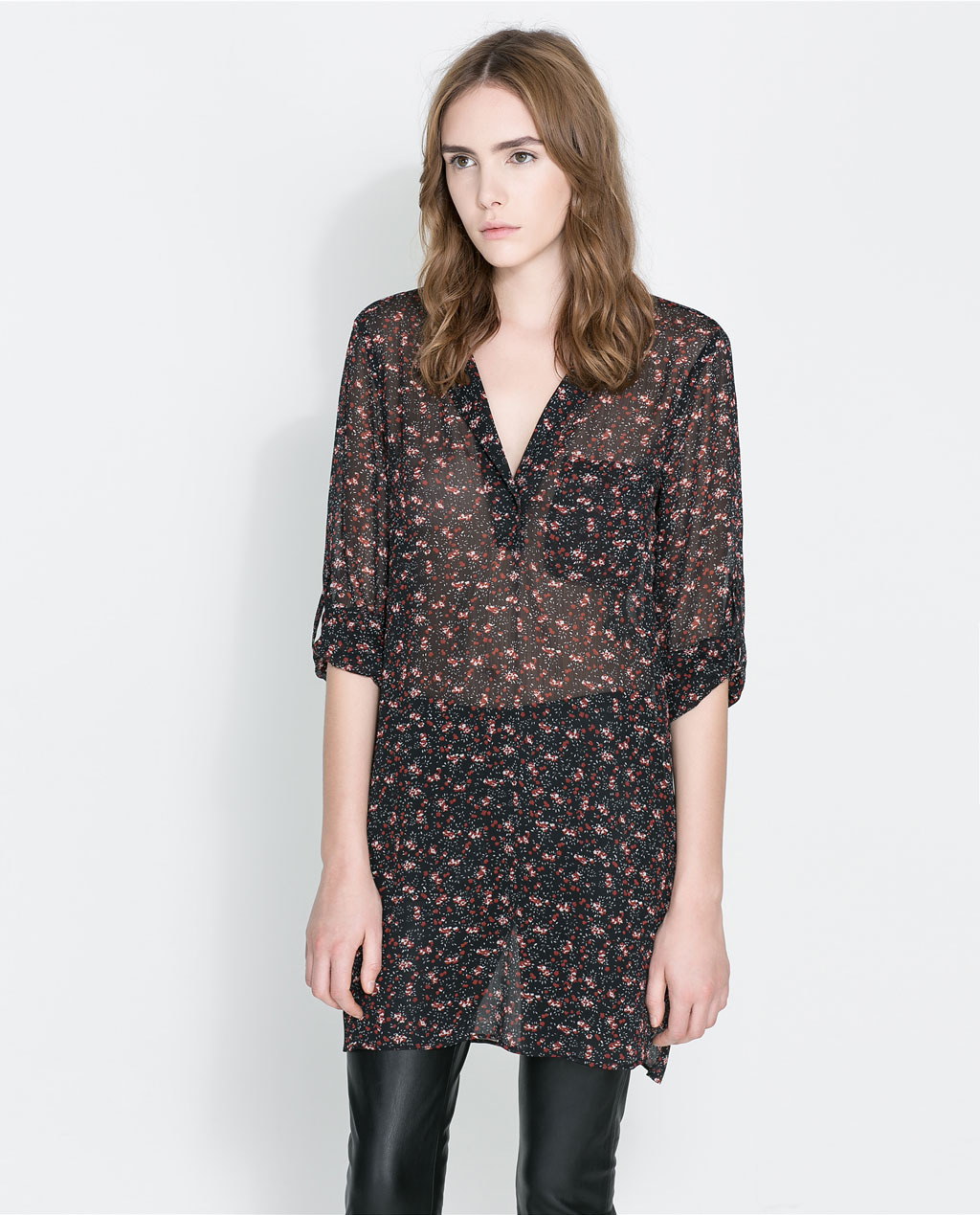 Floral Print Tunic - style: shift; length: mid thigh; neckline: low v-neck; fit: loose; predominant colour: black; occasions: casual, evening, occasion, holiday, creative work; fibres: polyester/polyamide - 100%; sleeve length: 3/4 length; sleeve style: standard; texture group: sheer fabrics/chiffon/organza etc.; pattern type: fabric; pattern: patterned/print; trends: broody brights; season: a/w 2013